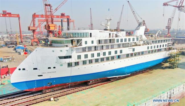 Photo taken on March 12, 2019 shows the first China-made cruise ship for polar expeditions, in Haimen, east China's Jiangsu Province. The first China-made cruise ship for polar expeditions tested the water on Tuesday in Haimen, east China's Jiangsu Province. Hu Xianfu, general manager of the shipbuilder China Merchants Group, said the 104.4-meters long vessel is 18.4 meters at the beam. It can operate at a speed of 15.5 knots. With a gross tonnage of 7,400 tonnes, it can accommodate 255 people on board. [Photo: Xinhua/Xu Congjun]