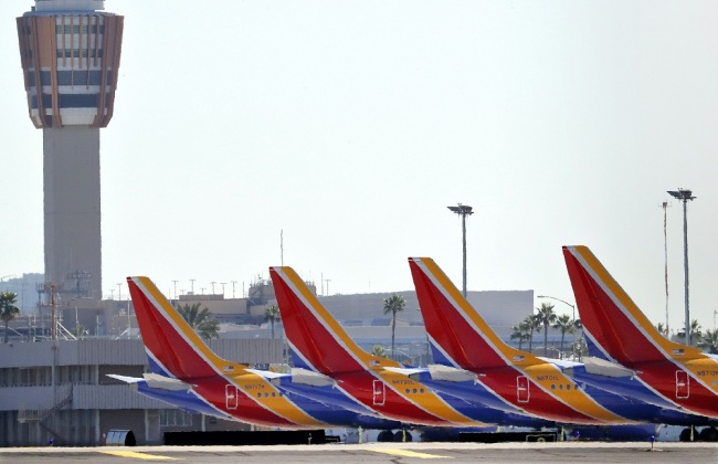 Boeing 737 Max jets are grounded at Sky Harbor International Airport, Thursday, March 14, 2019 in Phoenix. The U.S. issued an immediate emergency order Wednesday, grounding all 737 Max 8 and Max 9 aircraft in the wake of the crash of an Ethiopian Airliner. [Photo: IC]