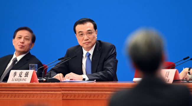 Premier Li Keqiang meets the press after the conclusion of the second session of the 13th National People's Congress at the Great Hall of the People in Beijing on Friday, March 15, 2019. [Photo: Xinhua]