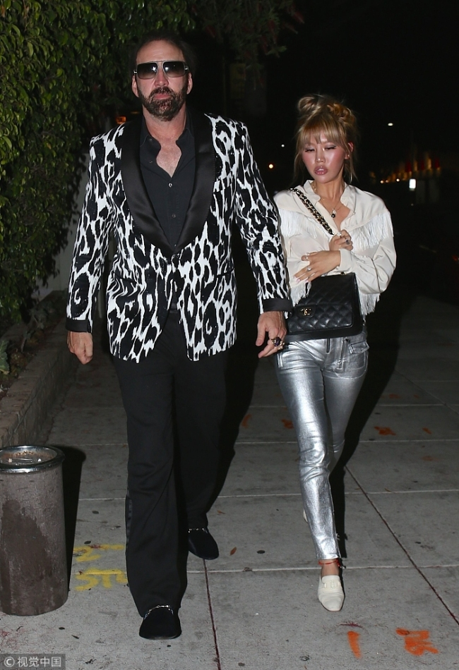 Actor Nicolas Cage rocked a zebra-print sportcoat after having dinner with girlfriend Erika Koike in Beverly Hills. [File Photo: VCG]
