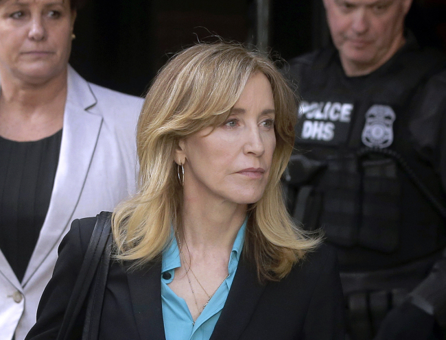 In this April 3, 2019 file photo, actress Felicity Huffman arrives at federal court in Boston to face charges in a nationwide college admissions bribery scandal. In a court filing on Monday, April 8, 2019, Huffman agreed to plead guilty in the cheating scam. [File Photo: AP/Steven Senne]