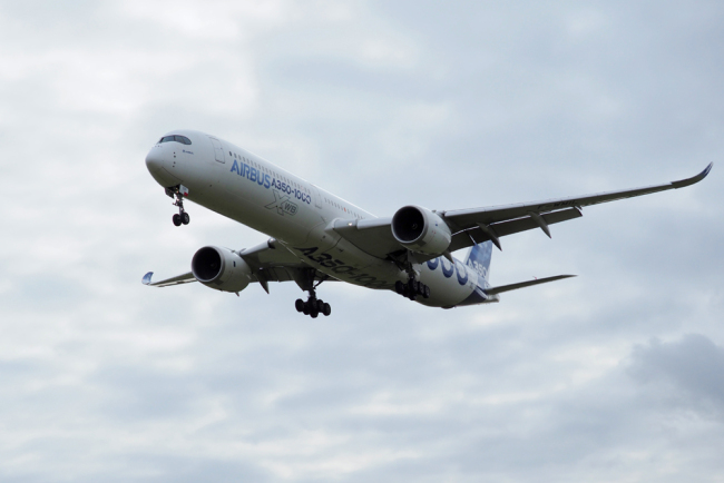 In this file photo taken on February 8, 2019 an Airbus A350-1000 conducts a test flight over Chateauroux airport, central France. [File Photo: AFP]