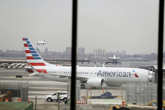 In a March 13, 2019 file photo, an American Airlines Boeing 737 MAX 8 sits at a boarding gate at LaGuardia Airport in New York. American Airlines is canceling 115 flights per day through mid-August because of ongoing problems with the Boeing 737 Max aircraft. [File photo: AP/Frank Franklin II]
