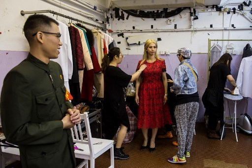 "Actress Man Chan (centre R), dressed as Ivanka Trump, gets ready back stage during a rehearsal of a Cantonese opera called ""Trump on Show"", in Hong Kong on April 11, 2019. [Photo:AFP]"