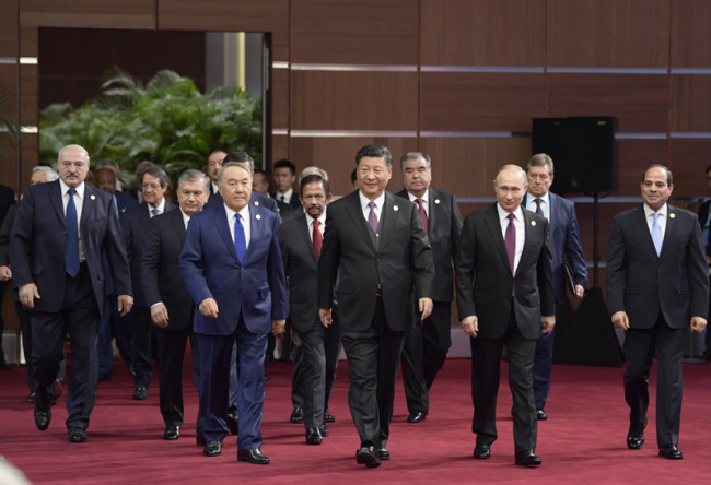 President Xi Jinping and world leaders enter the conference room for the opening ceremony of the second Belt and Road Forum for International Cooperation on Friday, April 26, 2019. [Photo: Xinhua]