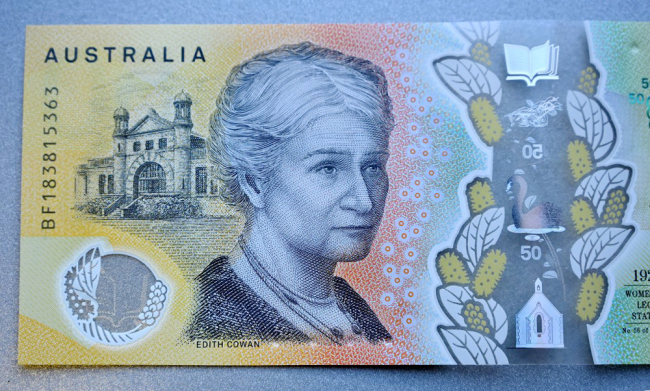 This photo illustration shows the detail in Australia's state-of-the-art new 50 dollar banknote in Sydney on May 9, 2019, with a spelling mistake in the microprint of a speech by Australia's first woman parliamentarian Edith Cowan. [Photo: AFP]