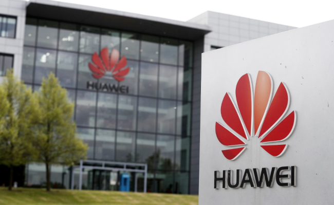 A logo of Huawei and signage at the company's main UK offices in Reading, west of London, on April 29, 2019. [Photo: AFP]