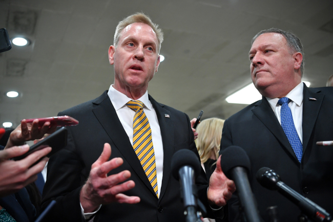 United States Secretary of Defense Patrick Shanahan (L) and US Secretary of state Mike Pompeo give a statement after a closed-door briefing on Iran in the auditorium of the Capitol Visitors Center in Washington, DC on May 21, 2019. [Photo: AFP/Mandel Ngan]