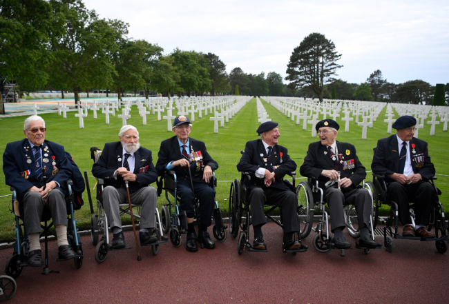 WWII British veterans stand before a remembrance ceremony at The Normandy American Cemetery in Colleville-sur-Mer on June 4, 2019, as part of events for the 75th anniversary of D-Day. [Photo: AFP/Damien Meyer]