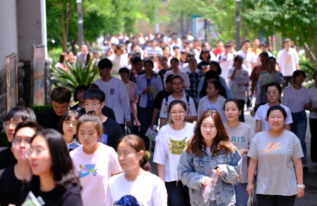 Students walk out of the examination room in Shenyang, Liaoning Province on June 7, 2019. [Photo: IC]
