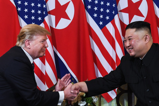 In this file photo taken on February 27, 2019 US President Donald Trump (L) shakes hands with North Korea's leader Kim Jong Un following a meeting at the Sofitel Legend Metropole hotel in Hanoi. [Photo: AFP]