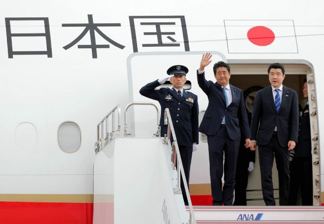 Japan's Prime Minister Shinzo Abe (C) waves to well-wishers upon his departure at Tokyo's Haneda Airport on June 12, 2019. Abe left for a two-day visit to Iran. [Photo: AFP]