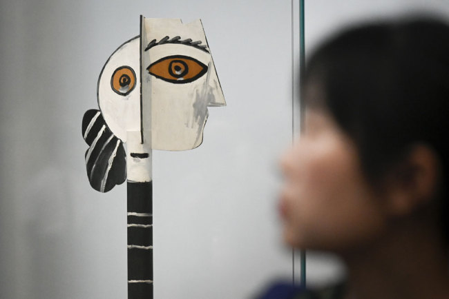 """This picture taken on June 14, 2019 shows a painted and cut wood entitled """"Head of Woman"""" by Pablo Picasso during an exhibition """"Picasso Birth of a Genius"""" at an art gallery in Beijing. [Photo: AFP/Wang Zhao]"""
