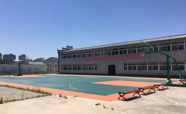 Specially built dormitories and facilities like a basketball court at the Feixi Precast Box Girder Factory are in contrast to the filthy and poor living conditions migrants workers are often subjected to. [Photo: Chinaplus]
