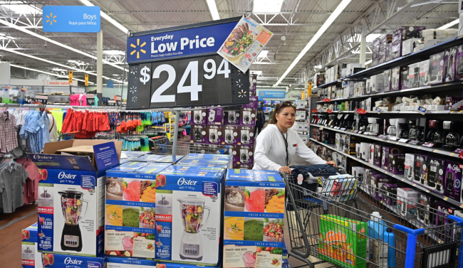 A woman shops at a Walmart Supercenter store in Rosemead, California on May 23, 2019. [Photo: AFP]