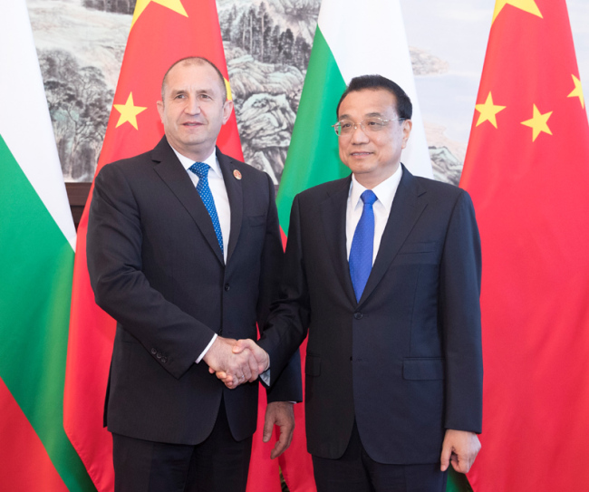 Premier Li Keqiang meets with Bulgarian President Rumen Radev on the sidelines of the World Economic Forum in Dalian, northeast China's Liaoning provinceon Monday, July 1, 2019.[Photo: gov.cn]