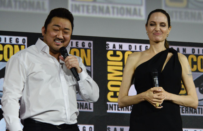 Angelina Jolie is introduced as a cast member for the latest Marvel Superhero film The Eternals during the Marvel Panel in Hall H during day 3 of 2019 Comic-Con in San Diego, Ca, July 20, 2019. Pictured: Dong -Seok Ma, Angelina Jolie. [Photo: IC]