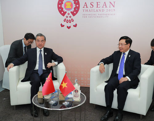 Chinese State Councilor and Foreign Minister Wang Yi meets with Vietnamese Deputy Prime Minister and Minister for Foreign Affairs Pham Binh Minh in Bangkok, capital of Thailand, on Thursday, August 1, 2019. [Photo: fmprc.gov.cn]