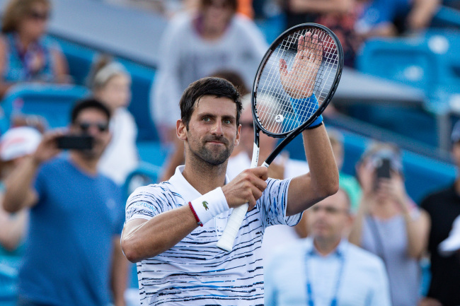 Novak Djokovic (SRB) applauds the crowd after winning his match at Tuesday's round of the Western and Southern Open at the Lindner Family Tennis Center, August 13, 2019. [Photo: ZUMA via IC/Scott Stuart]