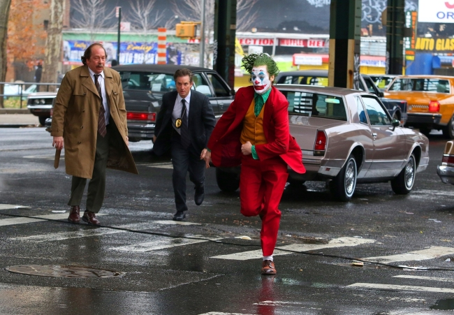 Actor Joaquin Phoenix in full joker costume and make-up was seen running at full speed while filming an intense scene where he is being pursued by co-stars Shea Whigham and Bill Camp for the 'Joker' movie. [File Photo: BACKGRID/Backgrid via VCG]