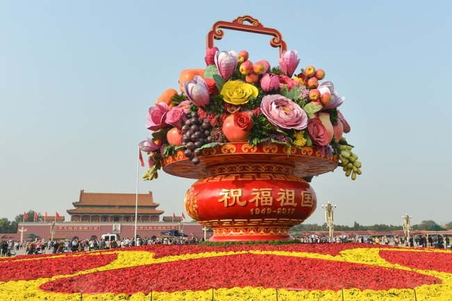 A general view of a huge flower and fruit basket monument at Tiananmen Square in Beijing, September 27, 2017. [File Photo: IC]