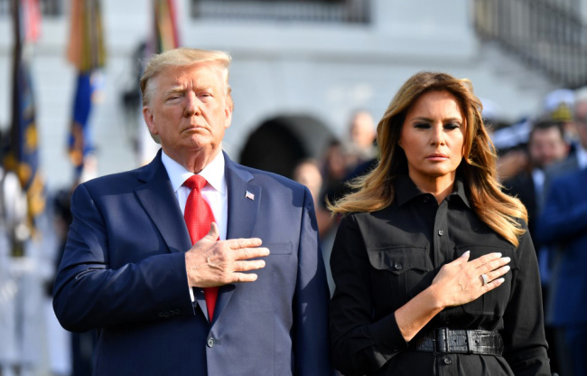 U.S. President Donald Trump and First Lady Melania Trump observe a moment of silence at the White House to mark the 18th anniversary of the 9/11 attacks on September 11, 2019, in Washington, DC. [Photo: AFP/Nicholas Kamm]