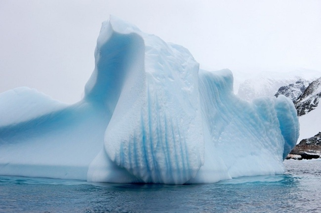 Iceberg with line markings and waterline erosion near cuverville island Antarctica. [File Photo: IC]