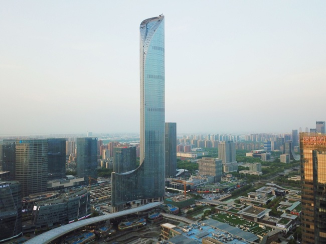 An aerial view of a skyscraper resembling an officer boot of ancient Chinese dynasties on the bank of Jinji Lake in Suzhou city, east China's Jiangsu province, April 15, 2018. [File Photo: IC]