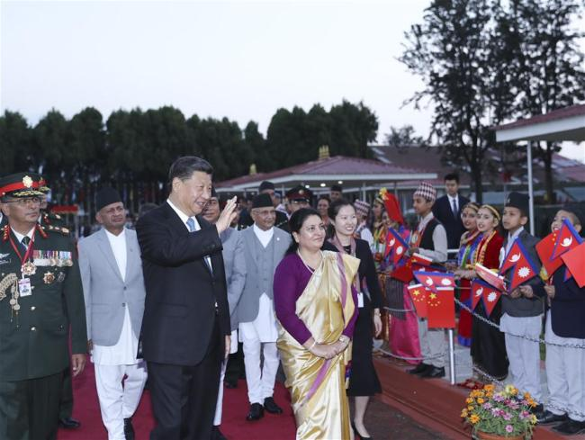 Chinese President Xi Jinping attends a welcome ceremony held by Nepali President Bidya Devi Bhandari upon his arrival at the airport in Kathmandu, Nepal, Oct. 12, 2019. [Photo: Xinhua/Ju Peng]
