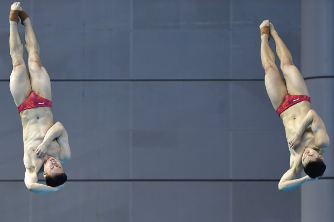 Xie Siyi (left) and Wang Zongyuan during the diving men's three-meter synchronized springboard final at the Military World Games in Wuhan on Saturday, October 27, 2019. [Photo provided to China Plus]