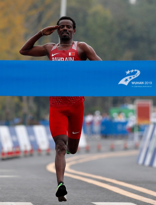 Shumi Leche of Bahrain crosses the finishing line in the men's individual marathon at the 7th Military World Games in Wuhan on Saturday, October 27, 2019. [Photo provided to China Plus]