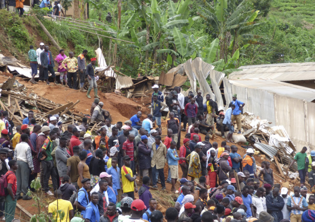 Rescue workers search through the rubble following a landslide in Bafoussam Cameroon, October 29, 2019. [Photo: AP]