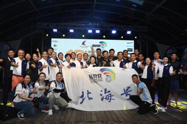 Sailors of the Chinese team Beihai pose for photos after the Belt and Road International Regatta Malaysia stage in Langkawi, Malaysia on Jan 11, 2020. [Photo provided to China Plus]