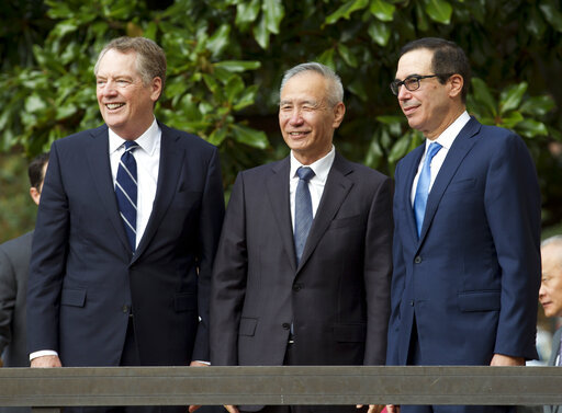 In this Oct. 11, 2019, file photo, Chinese Vice Premier Liu He, center right, shakes hands with U.S. Trade Representative Robert Lighthizer, center left, after a minister-level trade meeting at the Office of the United States Trade Representative in Washington. [File photo: AP]