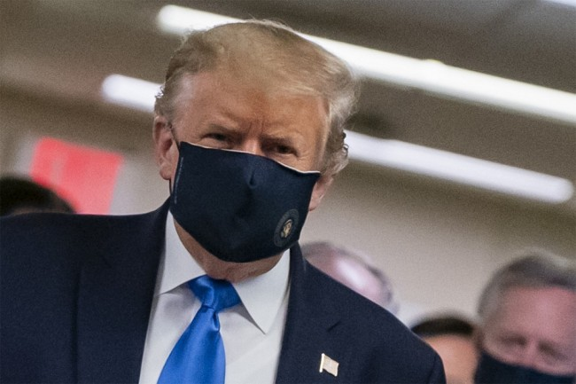 In this file photo taken on July 11, 2020 US President Donald Trump wears a mask as he visits Walter Reed National Military Medical Center in Bethesda, Maryland. US President Donald Trump, who for months refused to encourage mask wearing as a way to combat the coronavirus, on July 20, 2020 tweeted a picture of himself with his face covered and touted his patriotism. [File photo: AFP]