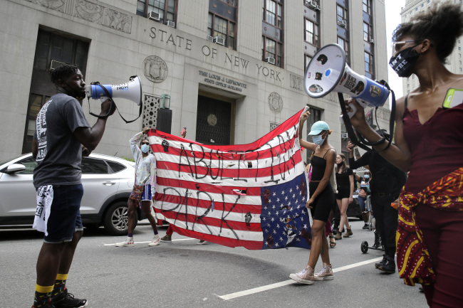 Protesters, many from the former encampment at City Hall Park, march for social justice in New York, Tuesday, July 28, 2020. [Photo: AP]<br>
