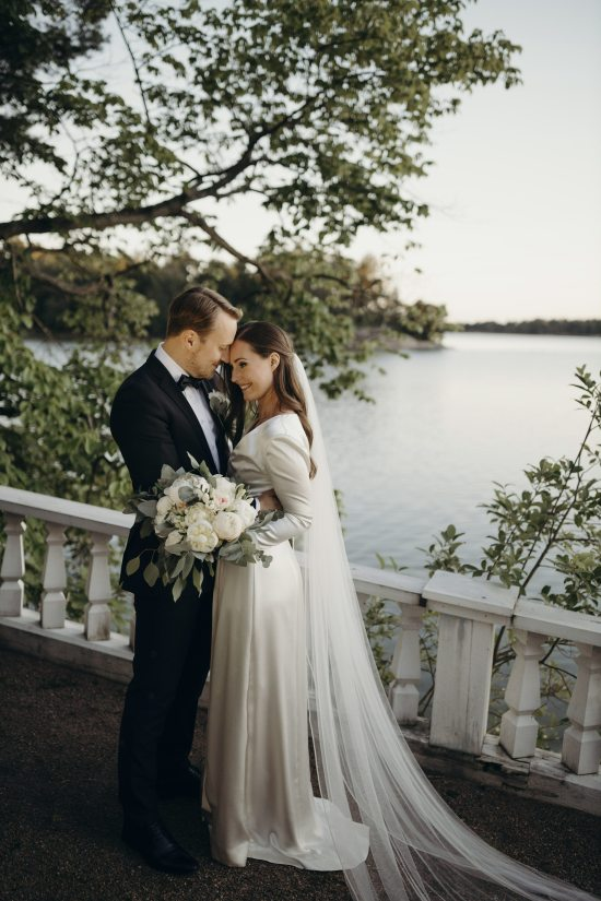 In this handout photo provided by the Finnish Prime Minister's Office on Sunday, Aug. 2, 2020, Finnish Prime Minister Sanna Marin and her new husband Markus Raikkonen pose for a photo after their wedding, at the PM's official residence Kesaranta in Helsinki. Finland's Prime Minister Sanna Marin announced Sunday that she has married her long-time partner, eight months after becoming the head of government. [Photo: AP/Minttu Saarni/Finnish Prime Minister's Office]