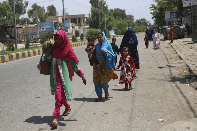 Afghan family leave their houses after an attack on a prison in the city of Jalalabad, east of Kabul, Afghanistan, Monday, Aug. 3, 2020. An Islamic State group attack on a prison in eastern Afghanistan holding hundreds of its members raged on Monday after killing people in fighting overnight, a local official said. [Photo: AP]