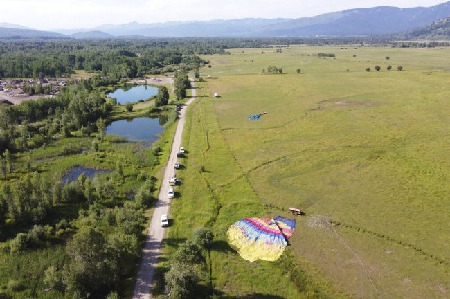 Two of three sightseeing balloons that crashed Monday, Aug. 3, 2020, are seen in an open area of Jackson Hole in western Wyoming. [Photo: AP]